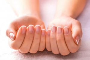 manicured-hands-on-white-towel